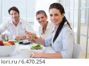 Купить «Workers eating lunch smile at camera», фото № 6470254, снято 20 ноября 2019 г. (c) Wavebreak Media / Фотобанк Лори