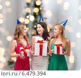 Купить «smiling women in party caps with gift boxes», фото № 6479394, снято 20 октября 2013 г. (c) Syda Productions / Фотобанк Лори