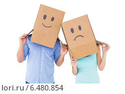 Купить «Couple wearing sad face boxes on their heads», фото № 6480854, снято 29 апреля 2014 г. (c) Wavebreak Media / Фотобанк Лори