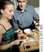 Купить «Young couple eating japanese food.», фото № 6491490, снято 29 февраля 2020 г. (c) BE&W Photo / Фотобанк Лори