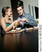 Купить «Young couple eating japanese food.», фото № 6493602, снято 29 февраля 2020 г. (c) BE&W Photo / Фотобанк Лори