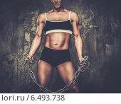 Купить «Muscular bodybuilder woman holding chains», фото № 6493738, снято 8 июня 2013 г. (c) Andrejs Pidjass / Фотобанк Лори