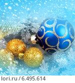Купить «Елочные украшения на новогоднем фоне со снежинками», фото № 6495614, снято 8 декабря 2011 г. (c) ElenArt / Фотобанк Лори