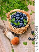 Купить «Свежие ягоды в плетеной корзине и гриб на столе», фото № 6500662, снято 25 сентября 2014 г. (c) Татьяна Волгутова / Фотобанк Лори