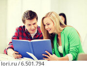 Купить «girl and guy reading book at school», фото № 6501794, снято 16 июня 2013 г. (c) Syda Productions / Фотобанк Лори