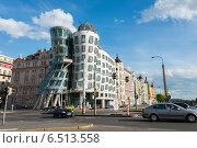 Купить «Prague - MAY 9, 2014: Dancing House on May 9 in Prague, Chech Republic. Dancing house is one of the most popular tourist attractions in Prague», фото № 6513558, снято 9 мая 2014 г. (c) Elnur / Фотобанк Лори