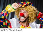 Купить «Funny clown in humorous concept against curtain», фото № 6514562, снято 18 июля 2014 г. (c) Elnur / Фотобанк Лори