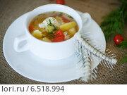 Купить «Рыбный суп в тарелке и рыбные кости», фото № 6518994, снято 12 октября 2014 г. (c) Peredniankina / Фотобанк Лори