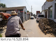Купить «Китай. Поездка на велорикше по старому Пекину», фото № 6520894, снято 10 сентября 2014 г. (c) Rokhin Valery / Фотобанк Лори