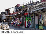 Купить «Китай, Пекин. Магазины на Яньдай Сецзе - старинной торговой улице», фото № 6520986, снято 9 сентября 2014 г. (c) Rokhin Valery / Фотобанк Лори