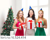 Купить «smiling women in party caps with gift boxes», фото № 6524414, снято 20 октября 2013 г. (c) Syda Productions / Фотобанк Лори