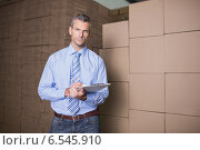 Купить «Portrait of manager with clipboard in warehouse», фото № 6545910, снято 10 мая 2014 г. (c) Wavebreak Media / Фотобанк Лори