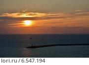 Купить «Маяк морского порта Сочи и корабль на фоне заходящего солнца», эксклюзивное фото № 6547194, снято 10 сентября 2014 г. (c) Александр Замараев / Фотобанк Лори