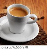 Купить «White cup of espresso coffee on wooden table», фото № 6556978, снято 10 октября 2014 г. (c) Tatjana Baibakova / Фотобанк Лори