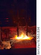 Газовая резка металлопроката. Стоковое фото, фотограф Iordache Carmen Anne Marie / Фотобанк Лори