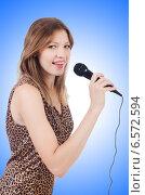 Купить «Woman singer with microphone on white», фото № 6572594, снято 25 августа 2013 г. (c) Elnur / Фотобанк Лори