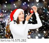 Купить «woman in santa helper hat with christmas ball», фото № 6575282, снято 15 августа 2013 г. (c) Syda Productions / Фотобанк Лори
