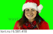 Купить «Festive brunette in santa hat blowing over hands», видеоролик № 6581418, снято 15 июля 2020 г. (c) Wavebreak Media / Фотобанк Лори