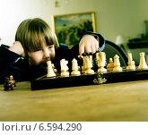 Купить «A child boy playing chess.», фото № 6594290, снято 17 сентября 2019 г. (c) BE&W Photo / Фотобанк Лори