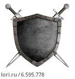 Купить «Средневековый рыцарский щит и мечи как герб», фото № 6595778, снято 3 сентября 2010 г. (c) Андрей Кузьмин / Фотобанк Лори