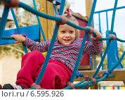 Excited girl developing dexterity at playground. Стоковое фото, фотограф Яков Филимонов / Фотобанк Лори