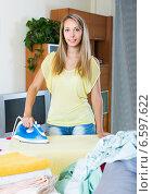 Купить «Blonde housewife ironing with iron», фото № 6597622, снято 10 апреля 2020 г. (c) Яков Филимонов / Фотобанк Лори