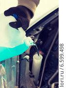 Купить «closeup of man pouring antifreeze into water tank», фото № 6599498, снято 16 января 2014 г. (c) Syda Productions / Фотобанк Лори