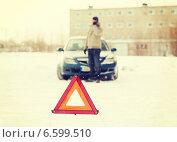 Купить «closeup of man with broken car and smartphone», фото № 6599510, снято 16 января 2014 г. (c) Syda Productions / Фотобанк Лори
