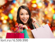 Купить «smiling woman with colorful shopping bags», фото № 6599990, снято 22 сентября 2013 г. (c) Syda Productions / Фотобанк Лори