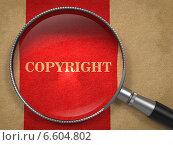 Купить «Слово Copyright под увеличительным стеклом», иллюстрация № 6604802 (c) Илья Урядников / Фотобанк Лори