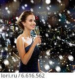 Купить «smiling woman holding glass of sparkling wine», фото № 6616562, снято 1 июня 2014 г. (c) Syda Productions / Фотобанк Лори