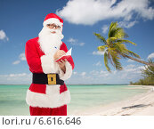 man in costume of santa claus with notepad. Стоковое фото, фотограф Syda Productions / Фотобанк Лори