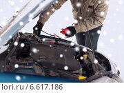 Купить «closeup of man under bonnet with starter cables», фото № 6617186, снято 16 января 2014 г. (c) Syda Productions / Фотобанк Лори