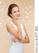 smiling woman in white dress with diamond ring. Стоковое фото, фотограф Syda Productions / Фотобанк Лори