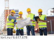 Купить «group of builders with tablet pc and blueprint», фото № 6617678, снято 21 сентября 2014 г. (c) Syda Productions / Фотобанк Лори