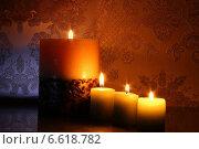 Пламя горящих свечей. Стоковое фото, фотограф ангелина кочугуева / Фотобанк Лори