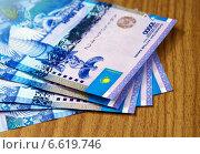 Купить «Денежные банкноты тенге, Казахстан», фото № 6619746, снято 7 августа 2013 г. (c) ElenArt / Фотобанк Лори