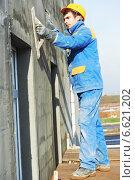 Купить «facade builder plasterer at work», фото № 6621202, снято 1 ноября 2012 г. (c) Дмитрий Калиновский / Фотобанк Лори