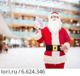 man in costume of santa claus with euro money. Стоковое фото, фотограф Syda Productions / Фотобанк Лори