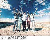 Купить «group of teenagers holding hands up», фото № 6627066, снято 20 июля 2013 г. (c) Syda Productions / Фотобанк Лори