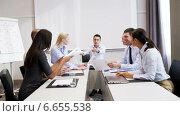 Купить «smiling business people meeting in office», видеоролик № 6655538, снято 30 октября 2014 г. (c) Syda Productions / Фотобанк Лори