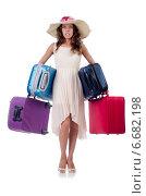 Купить «Woman with luggage isolated on the white», фото № 6682198, снято 29 августа 2013 г. (c) Elnur / Фотобанк Лори