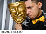 Купить «Funny concept with theatrical mask», фото № 6682654, снято 6 июля 2014 г. (c) Elnur / Фотобанк Лори