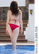 Купить «Woman in bikini near pool», фото № 6684934, снято 6 декабря 2019 г. (c) Яков Филимонов / Фотобанк Лори