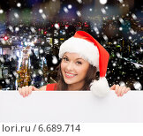 woman in santa helper hat with blank white board. Стоковое фото, фотограф Syda Productions / Фотобанк Лори