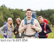Купить «group of smiling friends with backpacks hiking», фото № 6691854, снято 31 августа 2014 г. (c) Syda Productions / Фотобанк Лори