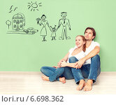 Купить «Счастливая молодая пара мечтает о новом доме, машине и семье», фото № 6698362, снято 4 ноября 2014 г. (c) Евгений Атаманенко / Фотобанк Лори