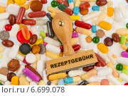 stamp on colorful tablets. Стоковое фото, фотограф Erwin Wodicka / Фотобанк Лори
