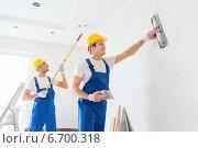 Купить «group of builders with tools indoors», фото № 6700318, снято 25 сентября 2014 г. (c) Syda Productions / Фотобанк Лори
