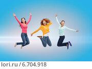 Купить «smiling young women jumping in air», фото № 6704918, снято 22 июня 2014 г. (c) Syda Productions / Фотобанк Лори